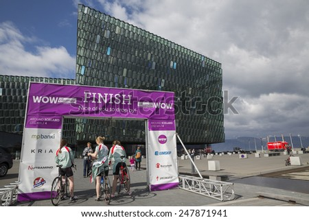 REYKJAVIK, ICELAND - June 19, 2013: Female participants wait for the start of Wow Cyclothon, a non-stop relay bike race around Iceland held annually on June 19, 2013 - stock photo