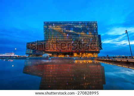 REYKJAVIK, ICELAND - March 23: Twilight scene of Harpa Concert Hall in Reykjavik, Iceland on March 23, 2015. The Harpa Concert Hall is the new landmark of the city, build in 2011.  - stock photo