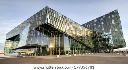 REYKJAVIK, ICELAND - Nov 23, 2013: Night scene of Harpa Concert Hall in Reykjavik harbor, Iceland during the day, the first purpose-built concert hall in Reykjavik. It was opened on May 4, 2013. - stock photo
