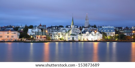 Reykjavik, Iceland. Panoramic image of Reykjavik, capital city of Iceland,  during twilight blue hour. - stock photo