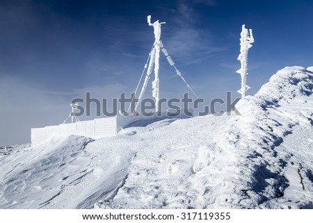 RF antennas covered by snow - Bieszczady Mountains - stock photo