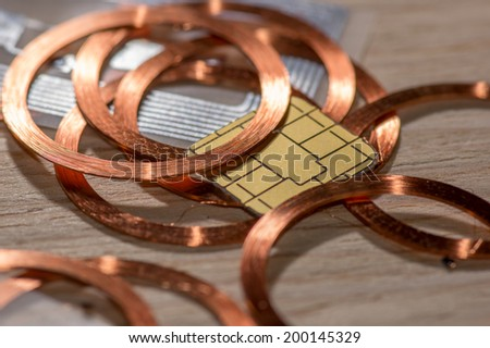 RFID Antenna copper coil contact chips processor - stock photo