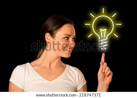 rful young asian caucasian woman pointing to copyspace - stock photo