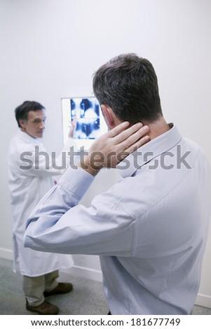Rheumatology Consultation Man - stock photo