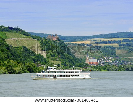 Rhine valley with cruise ship and castle Shonburg, Germany. Rhine Valley is UNESCO World Heritage Site - stock photo
