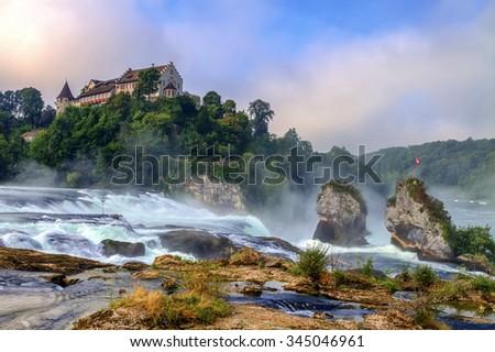 Rhinefalls in the grey morning fog, Switzerland - stock photo