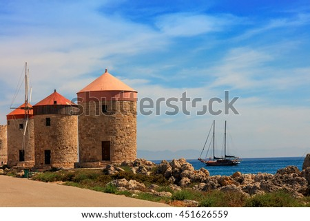 RHODES, GREECE - JUNE 13, 2016: Mandraki Harbour windmills on the Island of Rhodes Greece. - stock photo