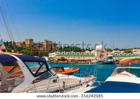 RHODES, GREECE - JUNE 16, 2015: Marina at the Mandraki harbor the main harbor of Rhodes for almost 2,500 years. - stock photo