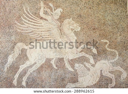 RHODES, GREECE - JUNE 12, 2015: Mosaic of a horseman fighting a lion at the Archeological Museum on Rhodes Island, Greece - stock photo