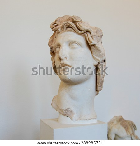 RHODES, GREECE - JUNE 12, 2015: Statue of Apollo, Greek God of the Sun, in the Archeological Museum of Rhodes, Greece - stock photo