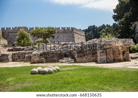 RHODES, RHODES CITY, GREECE - APRIL 23, 2017 ; Ruins of the castle and city walls of Rhodes. Defensive Fortress of the Joannites. .Historic castle on the shores of the Aegean and Mediterranean.