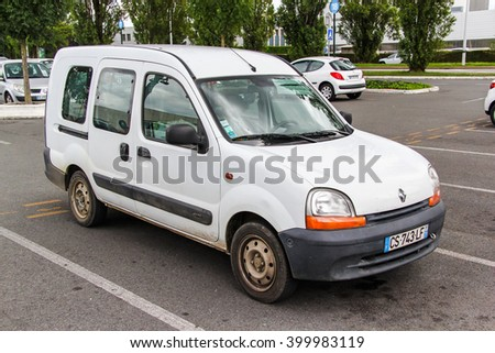 RHONE-ALPES, FRANCE - AUGUST 7, 2014: Motor car Renault Kangoo in the city street. - stock photo