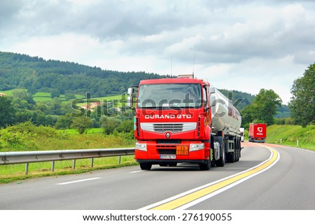 RHONE-ALPES, FRANCE - AUGUST 7, 2014: Red semi-trailer truck Renault Premium at the interurban road. - stock photo