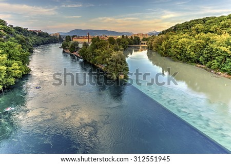 Rhone and Arve river confluence by sunset, Geneva, Switzerland, HDR - stock photo