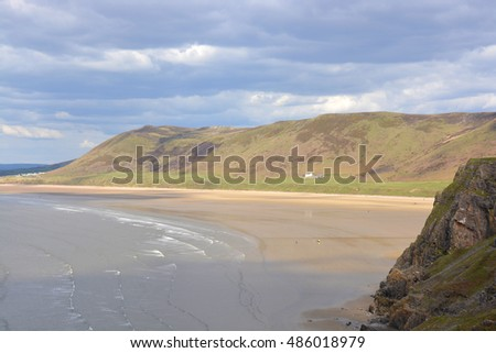Rhossili Bay with distant people on beach. Gower Peninsular, Wales, UK