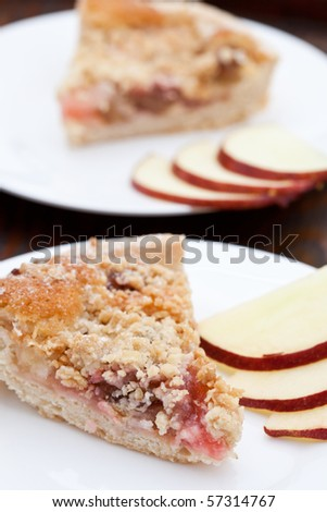 Rhubarb and apple crumble  pie with slices of apple - stock photo
