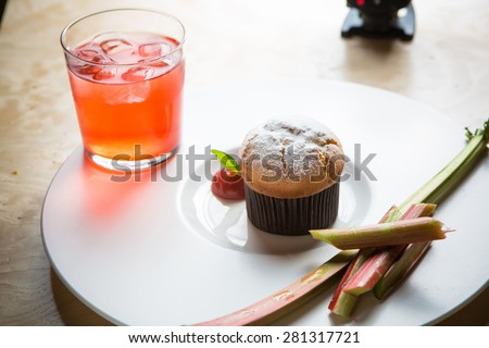 Rhubarb and ginger muffins on white plate