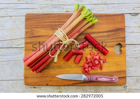 Rhubarb - fresh rhubarb in the kitchen - stock photo