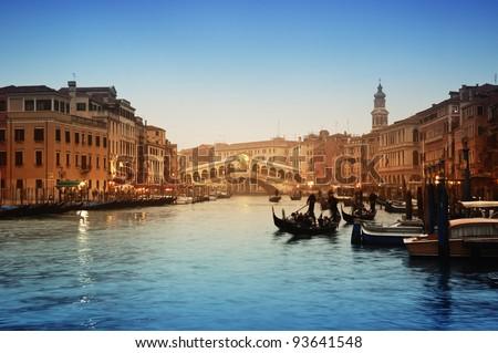 Rialto Bridge and gondolas  in Venice. - stock photo