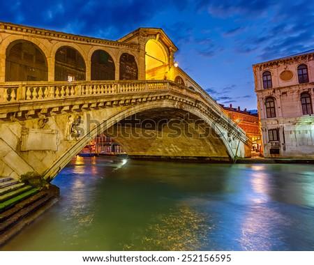 Rialto bridge at night in Venice, Italy - stock photo