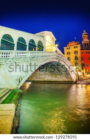 Rialto Bridge (Ponte Di Rialto) in Venice, Italy at night time - stock photo