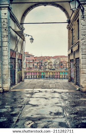 Rialto bridge, Venice, Italy, ancient European architecture, touristic city, grunge style photo, famous landmark, travel and tourism concept  - stock photo