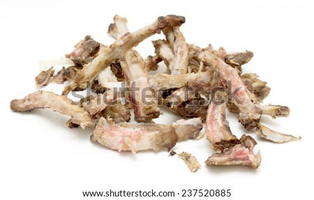 Rib bones picked clean of meat on a white background