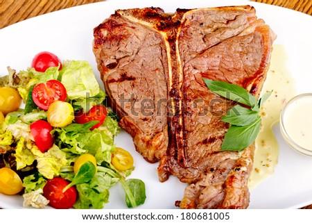 Rib eye steak and salad - stock photo