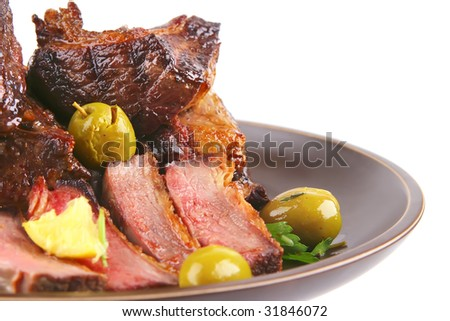 rib's and green olives on dish side view
