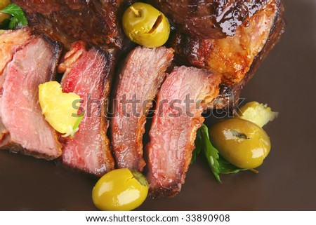 rib's and olive on dish top view - stock photo