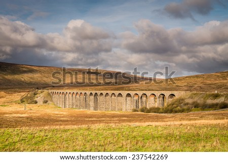 Ribblehead Viaduct / The Ribblehead Viaduct carries the Settle to Carlisle Railway across Batty Moss spanning 400 m and 32 m above the valley floor - stock photo