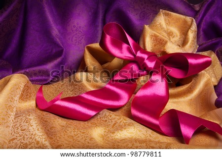 Ribbon and kerchief with expensive Indian fabric - stock photo