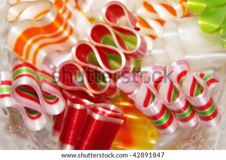 Ribbon candy in a glass dish - stock photo