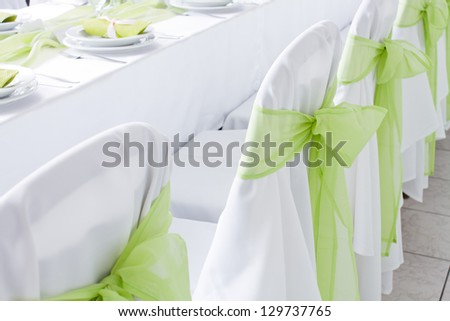 ribbon decoration on wedding chairs cover - stock photo