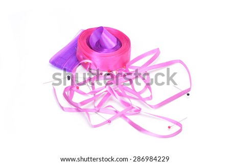 Ribbons and pins on a white background