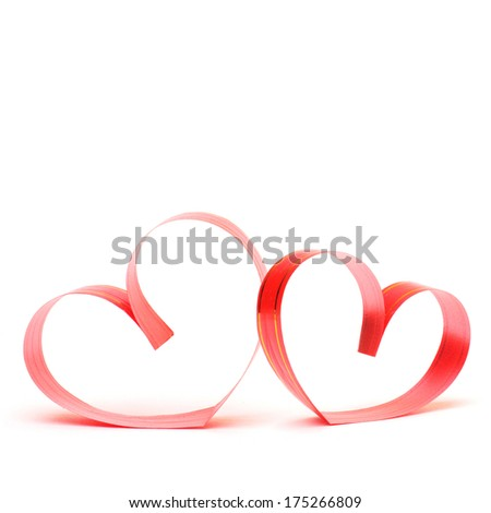 Ribbons shaped as hearts on white, valentines day concept - stock photo