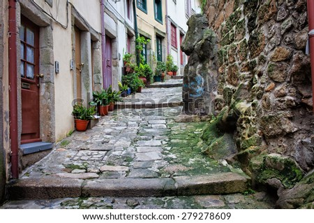 Ribeira Old Town of Porto in Portugal, sloping, narrow, medieval alley and traditional houses, historic city centre. - stock photo