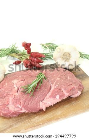 ribeye steak with garlic, chilli and rosemary - stock photo