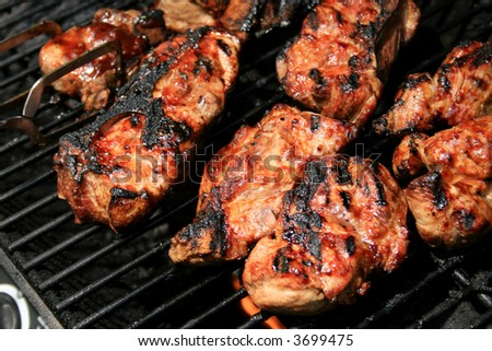 Ribs cooking on grill - stock photo