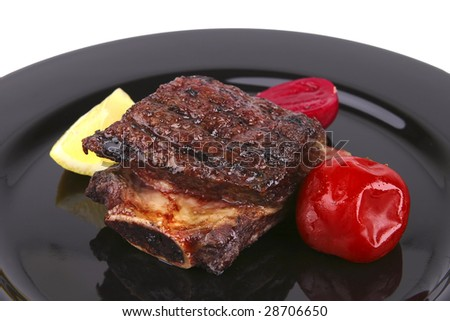 ribs on black dish over white background - stock photo