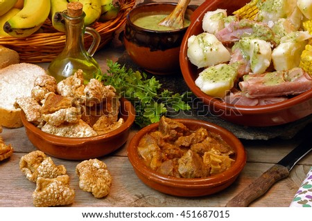 Ribs with mashed potatoes and gravy , goat meat and pork rinds , typical food of Tenerife, Canary Islands