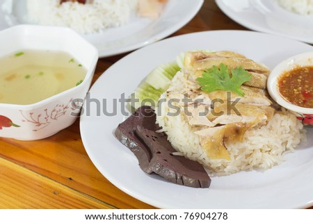 Rice and boiled chicken. (Thai food) Closeup Useful as background for design-works. - stock photo
