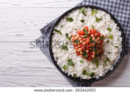 Rice and chickpeas in a tomato sauce on a plate. horizontal view from above - stock photo
