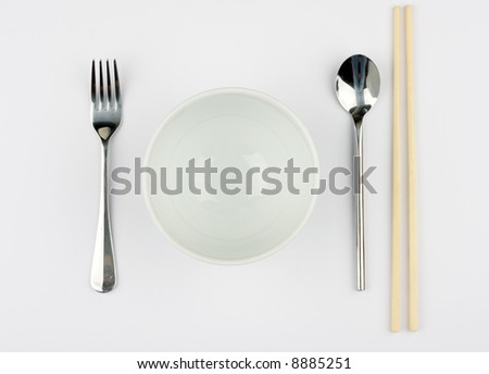 Rice and noodle bowl against a white tablecloth