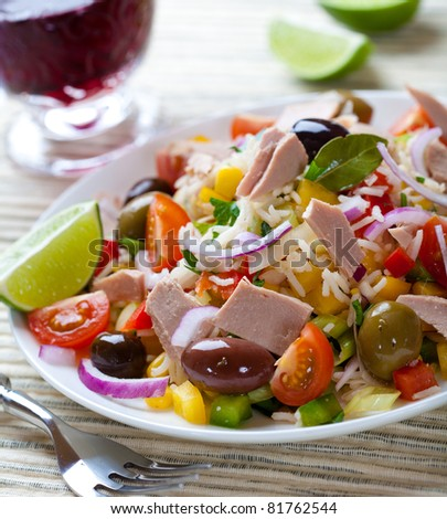 Rice and tuna salad with olives and vegetables