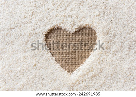 rice background Space in the middle of a heart. sackcloth is background - stock photo