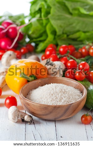 Rice basmati with raw vegetable for cooking, selective focus - stock photo