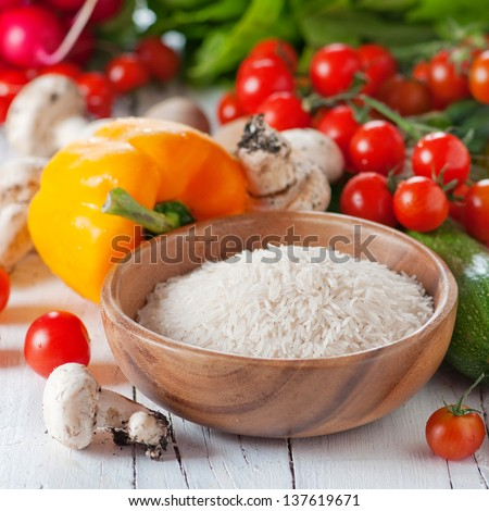 Rice basmati with raw vegetable for cooking, square image - stock photo