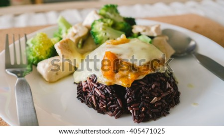 Rice berry and chicken breast. - stock photo