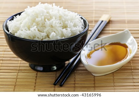 Rice bowl with soy sauce with chopsticks - stock photo